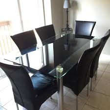 dining chairs sale mississauga. 7 piece leons dining table set. kept in good condition. glass and 6 chairs sale mississauga