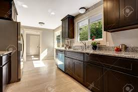 Modern Kitchen Tile Flooring Modern Kitchen Interior With Dark Brown Storage Cabinets With