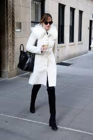 dakota johnson s street style and the white winter statement coat vogue