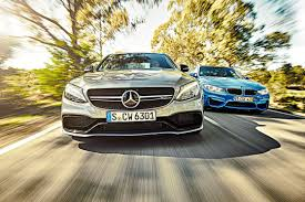 Mercedes-AMG C63 vs BMW M3 twin test review (2015) by CAR Magazine