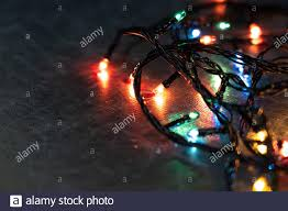 Christmas Lights That Look Like Light Bulbs Colored Light Bulbs Glow On The Table In The Dark Copy