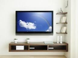 Use floating shelves to decorate your wall mounted television