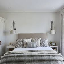 Modern Grey Bedroom With A Variety Of Patterned Cushions