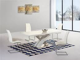 white extending gloss dining table and  chairs  homegenies