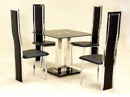 small square glass dining table and 4 faux chairs in black set