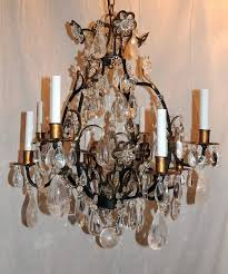 a lovely set of three french iron rock crystal chandeliers with eight lights in the