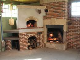 from left wood fired pizza oven with wood storage below wood burning fireplace