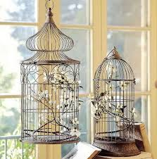Decorative bird cages in the interior, romantic decor ideas.