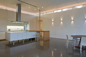minimalist lighting. fine minimalist minimalist eatin kitchen photo in new york with flatpanel cabinets and  white and lighting a