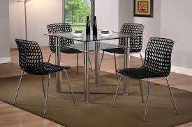 galaxy round clear glass dining table and 4 white chairs designs