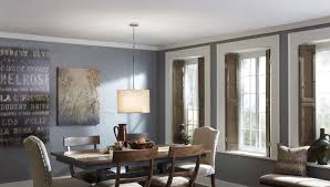 pendant light with fabric shade above a dining table