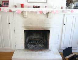 nice white brick wall painted fireplace and floating shelf as storage in traditional living areas decors