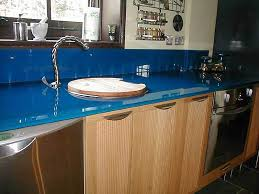 blue worktop with matching glass upstands fitted with led lights