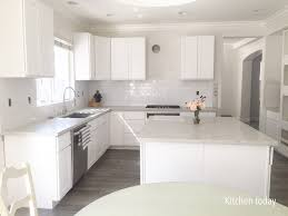 white shaker cabinets with quartz countertops. white shaker cabinets (still missing pulls \u0026 glass doors) with light gray quartz countertop countertops .