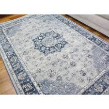 soft high quality persian look design floor area rugs elite washed pale blue with blue border