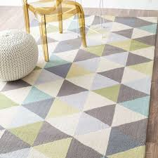 rashford hand hooked triangle multi rug is a handmade rugs that is made from wool blend mainly use for indoor the rugs is rectangle in shape with