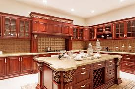 custom wood kitchen with glass faced cabinets cherry finish