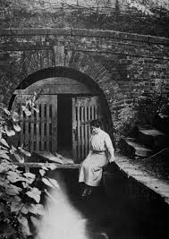 Coate Water Reservoir original outlet, 1895. Photographer unknown. Model  believed to be Polly Lawrence.   Water reservoir, Swindon, Water