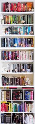 Colour-sorted Bookshelf + matching Funko Pop figurines (by Grace's Library)  <<<<these are some great books too<<<bookshelf goals