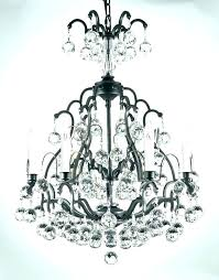 elegant wrought iron and crystal chandeliers or