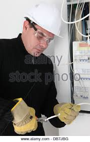 electrician fixing breaker box stock photo royalty image man fixing fuse box stock photo