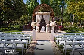 a fairytale come true the tuscan garden offers a charming spot for an intimate wedding fl agrarian arbors arch over the earthen pathway that leads the