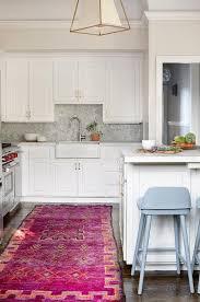 orange and hot pink rug in white kitchen