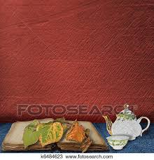 drawing the old book with leaves and teapot with cup of tea on the table