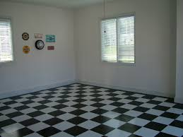 perfect retro garage interior decors with double glass windows also white wall painted also checd floor in black and white color schemes