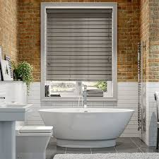 bathroom blinds. there are some fabulous and realistic looking faux wood blinds available which have the look of real but suitable for bathrooms kitchens bathroom