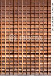 wooden grid wall stock photo