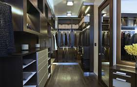 this modern closet boasts espresso finished cabinets and counters along with a hardwood flooring the