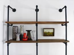 pipes and reclaimed wood wall shelf