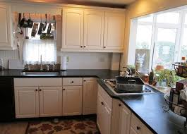 beautiful black soapstone countertop design with white kitchen cabinet