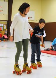 rollerskating unit helps students gain strength stay active zach spicer the tribune bethany brewster left a third grade teacher at brownstown elementary school roller skates third grader triston brenner
