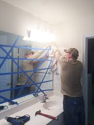 pulling down large bathroom mirror