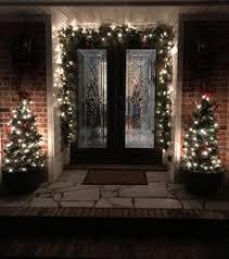 R Beautiful Entry  Garland Decor Verandainteriorscom   WinterChristmas Pinterest Silver Ornaments Holidays And Veranda Interiors