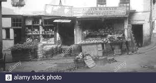 Austin Warner, Potato and Fruit Seller, Cow Keeper. - Croydon, Middle Row,  Old shops and houses - c. 1888 Stock Photo - Alamy