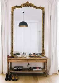 A Dreamy Paris Apartment mirror + small open sidetable