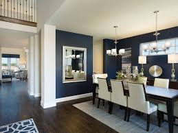 merie homes model home lantana beautiful navy walls dining room with ivory dining chairs modern chrome light fixture chandelier and dark wood floors