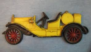 vintage ton car wall hanging cast iron yellow