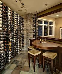 view in gallery wine cellar with compact seating area that comes in handy for a quick tasting barrel wine cellar designs