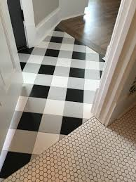 buffalo check tile flooring created using standard black white and gray tiles