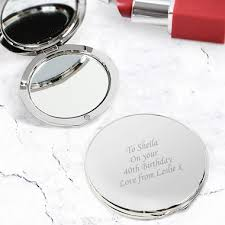silver round pact mirror
