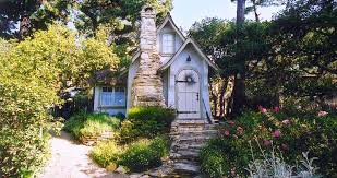 the village of carmel by the sea is dotted with fairytale cottages many of them built by hugh comstock carmel s builder of dreams