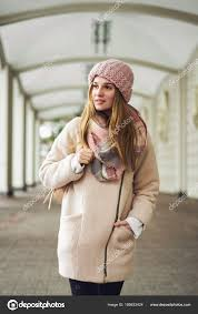 young girl wearing winter coat and scarf standing in the street pretty female with straight hair hairstyle photo by vitalii smulskyi gmail com