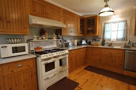 kitchen decorating ideas with oak cabinets dark brown wooden kitchen table white granite countertop fancy wooden round basket frosted glass vase with plant