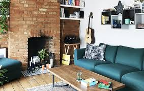 ikea business office furniture fascinating property sofa. a living room with green sofa and exposed brick wall ikea business office furniture fascinating property