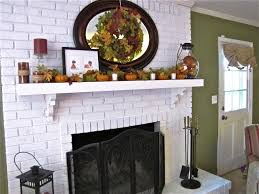 image of unique white brick fireplace with wood mantel decor