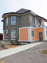 painting and plastering exterior stucco house wall facade thermal insulation and painting works during